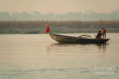 Cremation Ghat Photograph - Fishing Boat With Red Flag by Serena Bowles