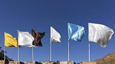 Flags Fluttering Against Blue Sky Art Print by Kantilal Patel