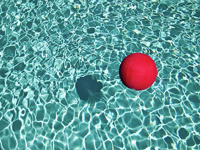 Water Reflections Photograph - Floating Red Ball In Blue Rippled Water by Mark A Paulda
