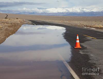 Flooded Road In The Desert Art Print by Paul Edmondson