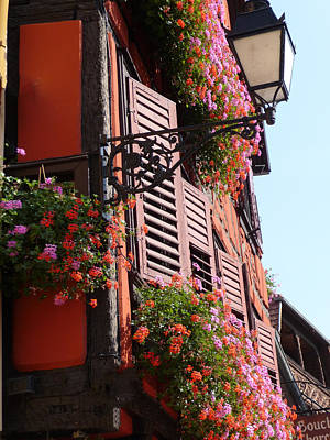 Flower Boxes And Shutters In Alsace Art Print by Christopher Mullard