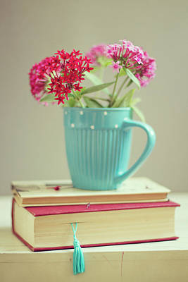 Colored Background Photograph - Flowers In Blue Cup On Two Books by Copyright Anna Nemoy(Xaomena)