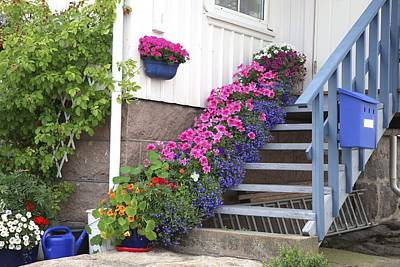 Flowers On Porch Stairs Art Print by Bjorn Svensson