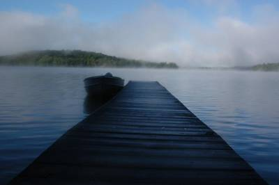 Docks Etc Photograph - Foggy Scene Of A Motor Boat Docked by Stacy Gold