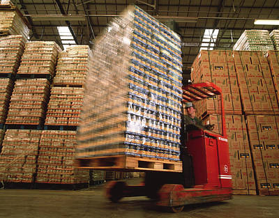 Lift Truck Photograph - Fork-lift Truck In Warehouse by David Parker