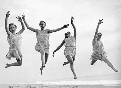 Beach Scenes Photograph - Four Dancers Leaping by Underwood Archives