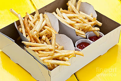 Food And Beverage Photos - French fries in box by Elena Elisseeva