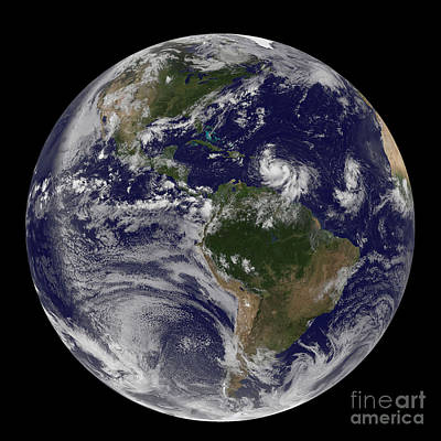 Photograph - Full Earth Showing Two Tropical Storms by Stocktrek Images