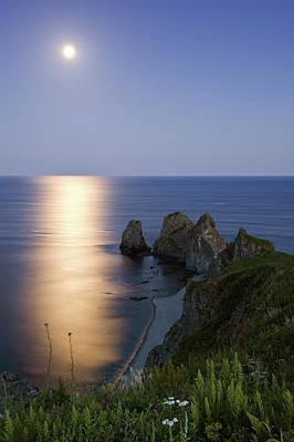 Sea Moon Full Moon Photograph - Full Moon On Cape Four Rocks by V. Serebryanskiy