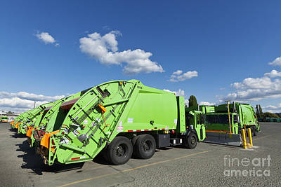 Garbage Trucks Parked Art Print by Don Mason