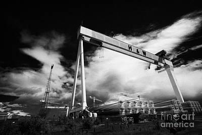 Giant Harland And Wolff Cranes Goliath Amd Samson With Wind Turbine Blades At Shipyard Titanic Art Print by Joe Fox
