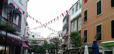 Photograph - Gibraltar Promenade Shops Uk by John Shiron