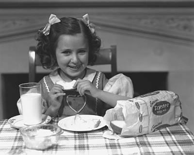 Girl (4-5) Eating Breakfast, (b&w) Art Print by George Marks