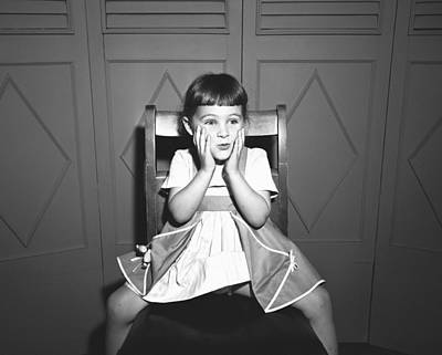 Girl (5-5) Sitting Astride Chair, Making Face, (b&w), Art Print by George Marks