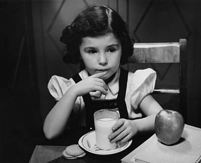 Girl (6-7) Sitting At Table, Having Breakfast, (b&w) Art Print by George Marks