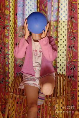Girl Blowing Up Balloon Art Print by Sami Sarkis