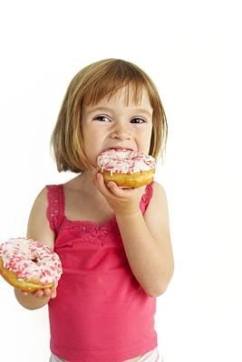 Girl Eating Doughnuts Art Print by Ian Boddy