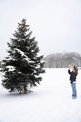 Girl Measuring Tree Height Print by Ted Kinsman