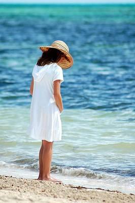 Photograph - Girl On A Beach by Sandra Sigfusson
