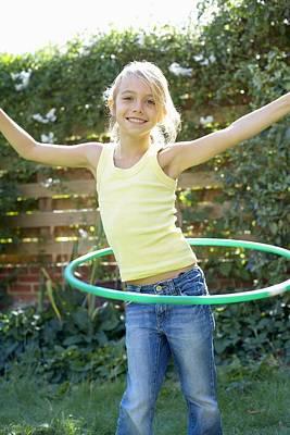Girl Playing With A Hula Hoop Art Print by Ian Boddy