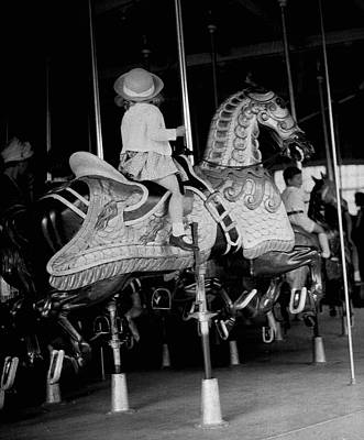 Girl Riding A Carousel Art Print by George Marks