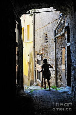 Girl Running Through A Cobblestone Street Art Print by Sami Sarkis