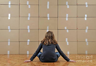 Girl Seated In Front Of Cardboard Boxes Art Print by Sami Sarkis