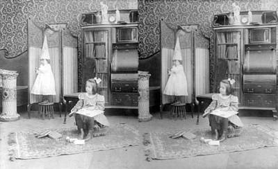 Dunce Cap Photograph - Girl Seated In Middle Of Room by Everett