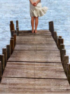 Girl Standing At The End Of A Dock Art Print by Jill Battaglia