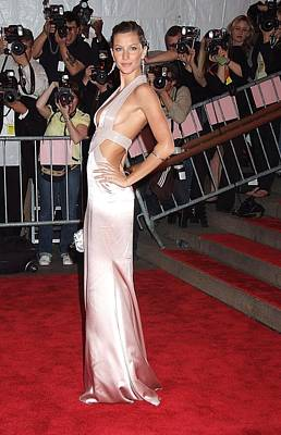 Versace Photograph - Gisele Bundchen Wearing A Versace Gown by Everett