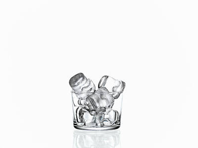Changing Form Photograph - Glass Filled With Ice Cubes by Zing Images