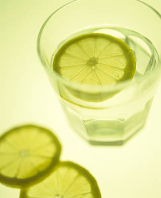 Photograph - Glass Of Water With Sliced Lemon by Lawrence Lawry
