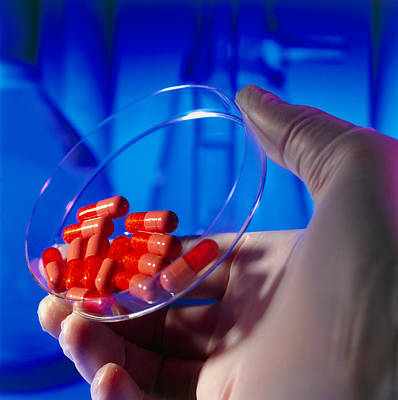 Time Capsule Photograph - Gloved Hand Holding A Dish Of Red Drug Capsules by Tek Image