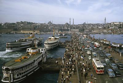 Golden Horn Ferries Dock At Ramps Print by Otis Imboden