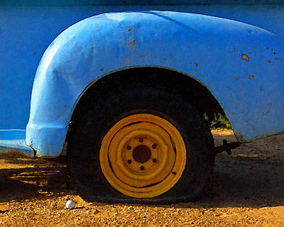 Photograph - Golf Ball And Flat Tire by Timothy Bulone