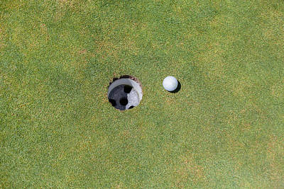 Y120831 Photograph - Golf Ball Next To The Hole by Tuan Tran
