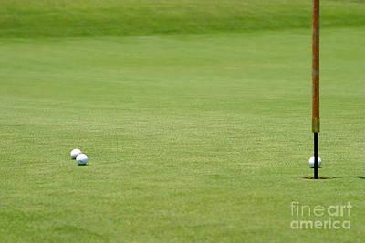 Golf Balls Near Flagstick Art Print by Henrik Lehnerer