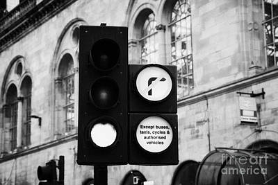 Green Traffic Light Signal With No Right Turn Except Buses Taxis Cycles And Authorised Vehicles Glas Art Print by Joe Fox