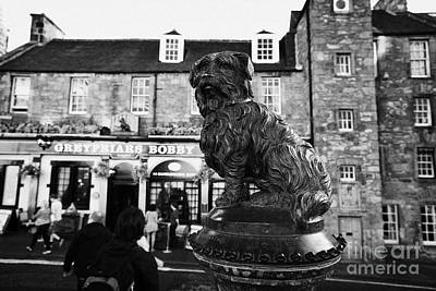 Scottish Dog Photograph - Greyfriars Bobby Statue In Front Of The Bar Candlemaker Row Edinburgh by Joe Fox