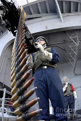 Gunners Mate Seaman Taking Aim Print by Stocktrek Images
