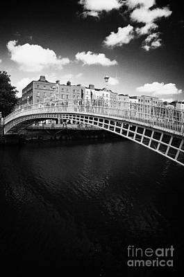 Hapenny Photograph - Halfpenny Hapenny Bridge Over The River Liffey In The Centre Of Dublin City Ireland by Joe Fox
