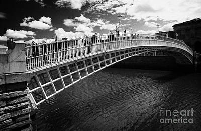 Hapenny Photograph - Halfpenny Hapenny Bridge Over The River Liffey In The Centre Of Dublin City Republic Of Ireland  by Joe Fox