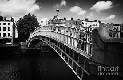 Hapenny Photograph - Halfpenny Hapenny Bridge Over The River Liffey In The Centre Of Dublin Eire Ireland by Joe Fox