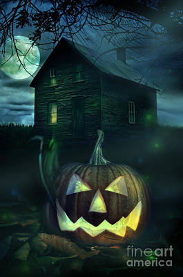 Photograph - Halloween Pumpkin In Front Of A Spooky House by Sandra Cunningham