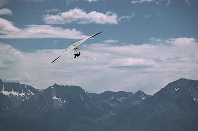 Hang Glider Pilot Flies In Front Print by Gordon Wiltsie