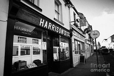Ballina Photograph - Harrisons Bar In A Row Of Pubs And Bars Ballina Town Centre County Mayo Republic Of Ireland by Joe Fox