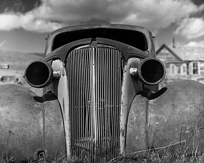 Photograph - Headlights And Grill With Clouds by Joe  Palermo