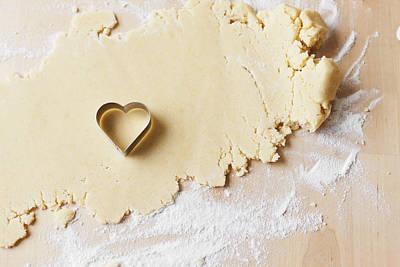 Heart Shaped Cookie Cutter On Dough Art Print by Cultura/Nils Hendrik Mueller