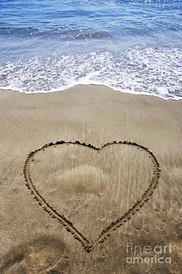 Heartshape Drawn In Sand On Beach Art Print by Sami Sarkis