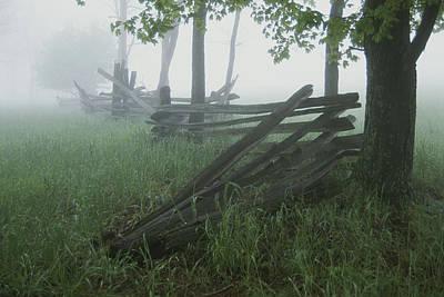 Heavy Fog Hangs Over Split Rail Fences Art Print by Stephen St. John